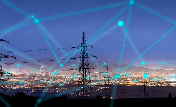 High,Power,Electricity,Poles,In,Urban,Area,Connected,To,Smart